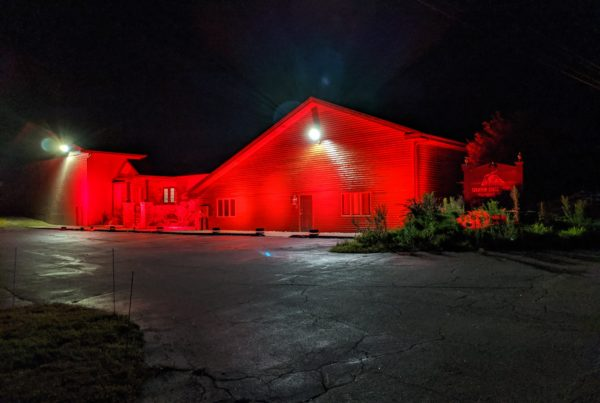 Creative Stage Lighting's North Creek, NY building lit red to support #WeMakeEvents, #redalertrestart, and #ExtendPUA